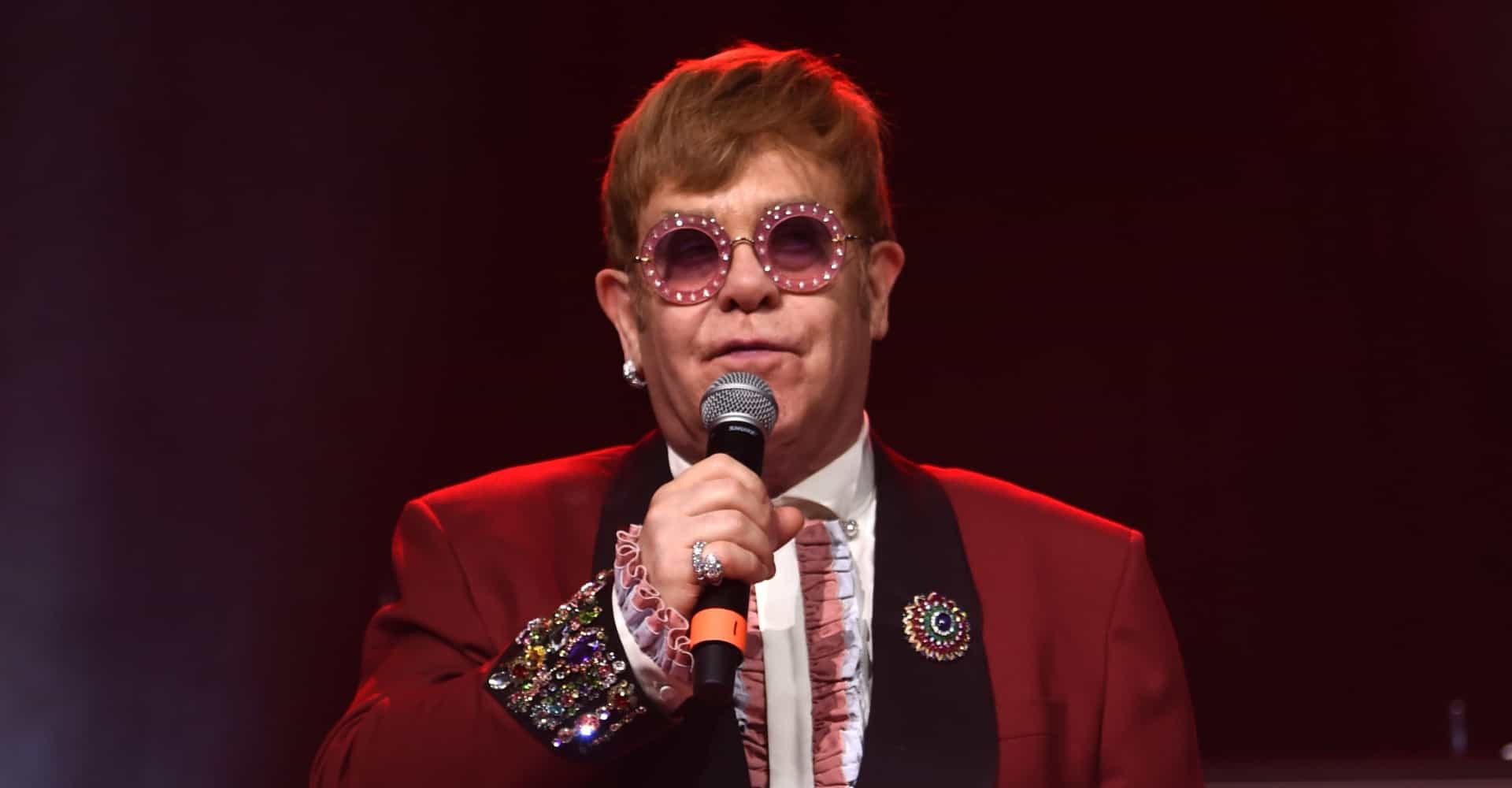 Elton John surrenders the stage after fan touches him during fight song