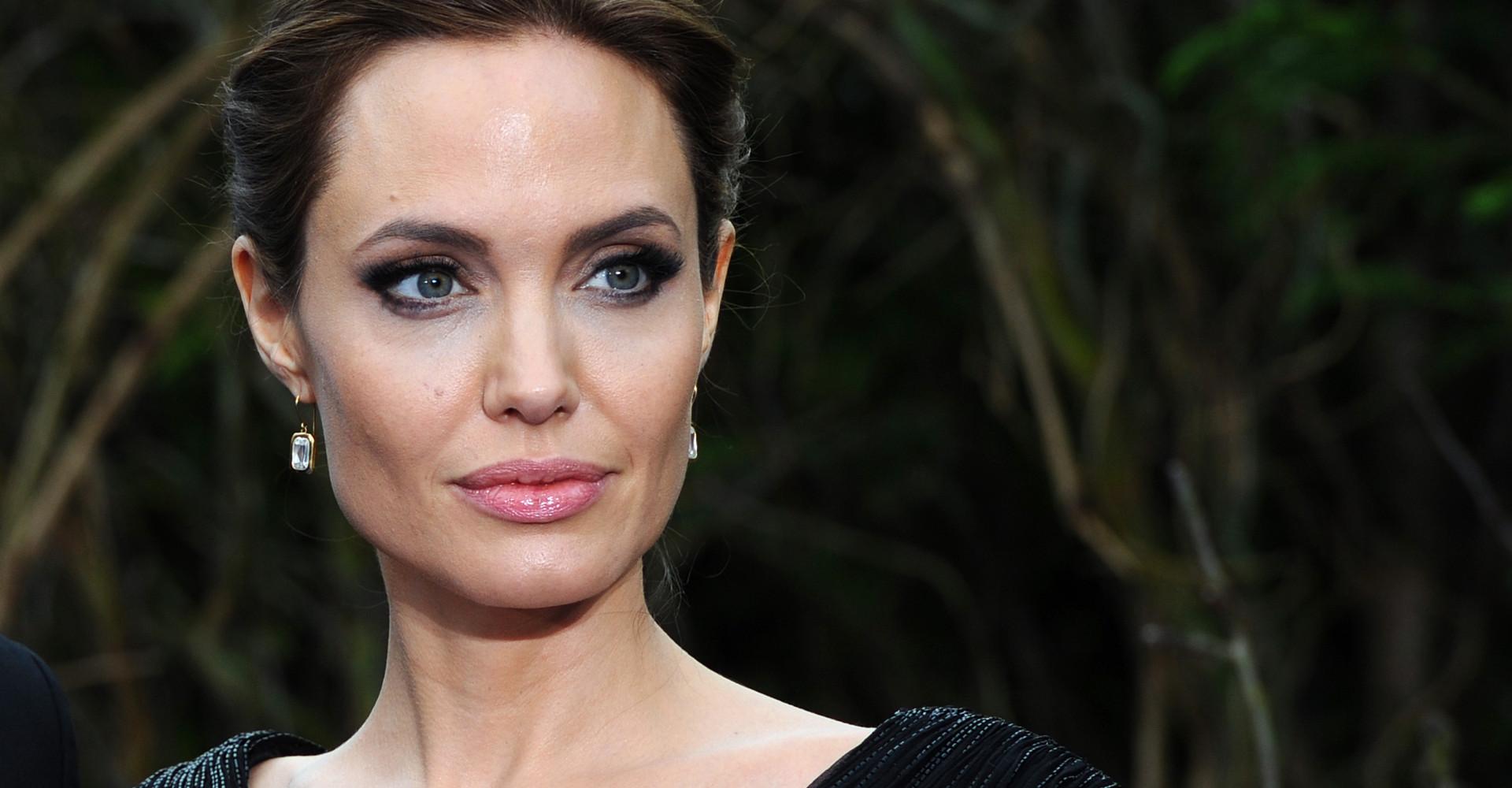 Why did Angelina Jolie fire her lawyer mid-custody battle?