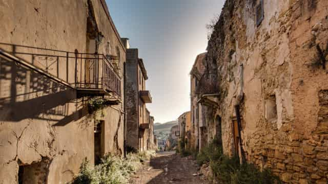 Explore the haunting Sicilian ghost town climbing out of its grave